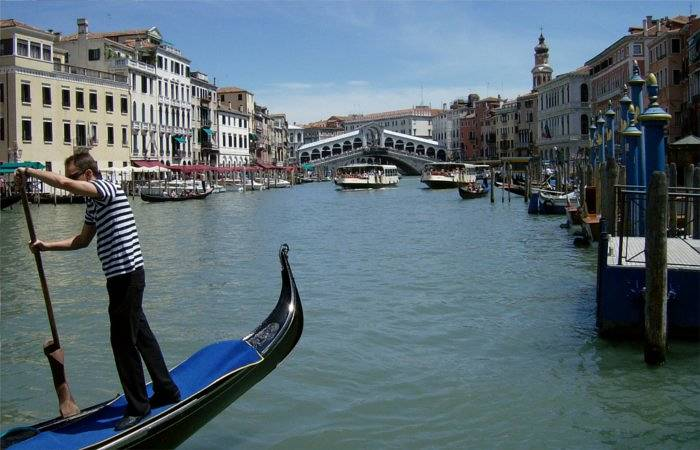 venice canals with gondola