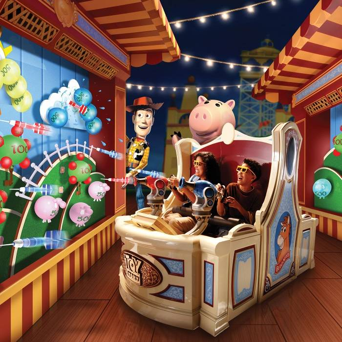 Riders on the Toy Story ride