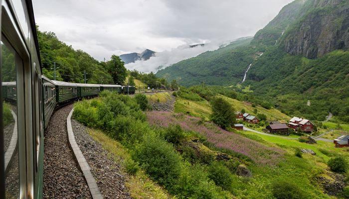 A train travelling through Scandinavian mountains