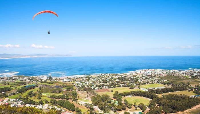 picture of someone paragliding over Cape Town