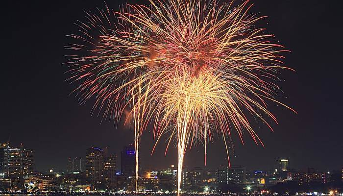 picture of fireworks over a city in Thailand