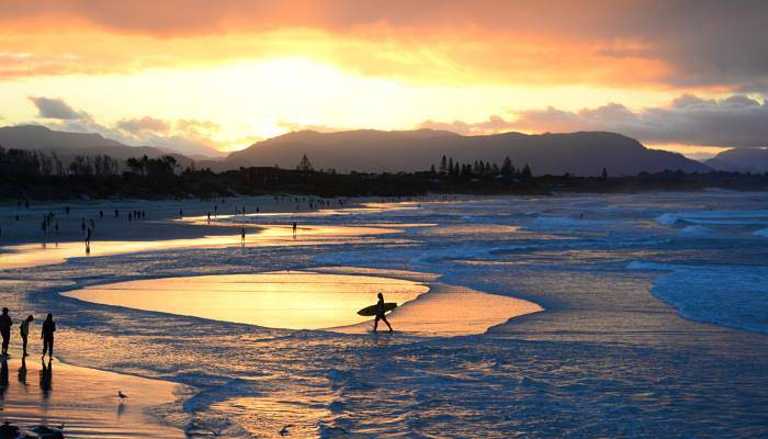 picture of surfers at Byron Bay