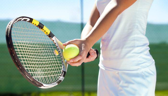 picture of woman playing tennis